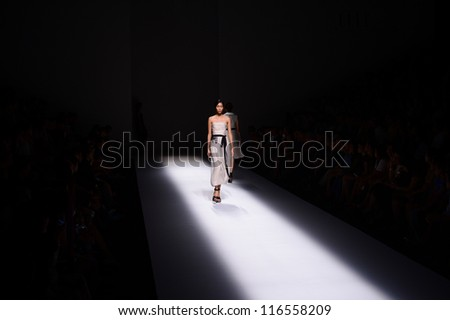 BANGKOK THAILAND-OCT12:A model walks on the catwalk showing for Vatit Itthi design by Thai designer Vatit Virashpanth and Itthi Metanee during Elle fashion week at Bangkok on Oct 12,2012 inThailand - stock photo