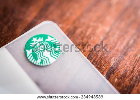 BANGKOK, THAILAND - OCT 27, 2014: A new Starbucks card available for member in Thailand. Starbucks is the world's largest coffee house with over 20,000 stores in 61 countries. - stock photo