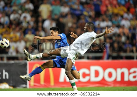 BANGKOK THAILAND - OCT 11: C.Chimtale of Thailand in action during FIFA WORLD CUP 2014 between Thailand(B) and Saudi Arabia(W) at Rajamangla Stadium on Oct 11, 2011 Bangkok, Thailand. - stock photo