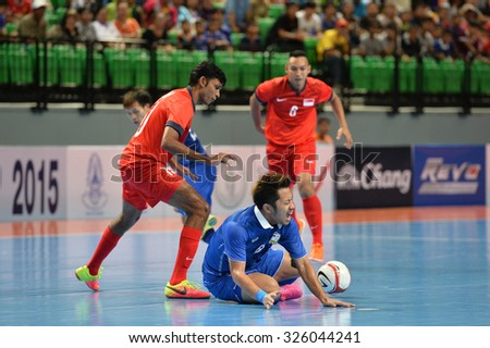 BANGKOK THAILAND-OCT9:Jetsada Chudech(Blue) of Thailand in action during 2015 AFF Futsal Championship Match between Thailand and Singapore at Bangkok Arena Stadium on October9,2015in Thailand