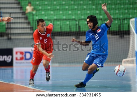 BANGKOK THAILAND-OCT8:Manuel Sa Sarmento(L) of Timor Leste in action during 2015 AFF Futsal Championship Match between Timor Leste and Singapore at Bangkok Arena Stadium on October8,2015 in Thailand