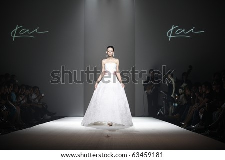 BANGKOK, THAILAND - OCT 21 :  Model showcases on the catwalk during BIFW fashion show on October 21, 2010 in Bangkok Thailand. - stock photo