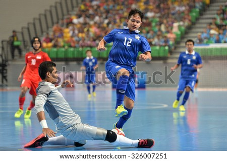 BANGKOK THAILAND-OCT9:Nuttavut Madyalan(Blue) of Thailand in action during 2015 AFF Futsal Championship Match between Thailand and Singapore at Bangkok Arena Stadium on October9,2015in Thailand