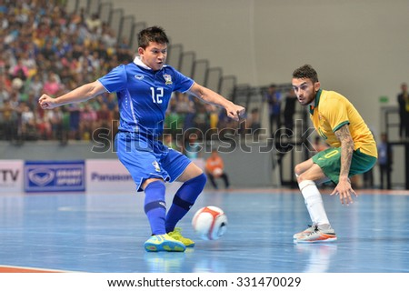 BANGKOK THAILAND-OCT16:Nuttavut Madyalan(Blue) of Thailand in action during 2015 AFF Futsal Championship Match between Thailand and Australia at Bangkok Arena Stadium on October16,2015 in Thailand