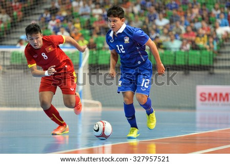 BANGKOK THAILAND-OCT14:Nuttavut Madyalan of Thailand in action during 2015 AFF Futsal Championship Match between Thailand and Vietnam at Bangkok Arena Stadium on October14,2015 in Thailand