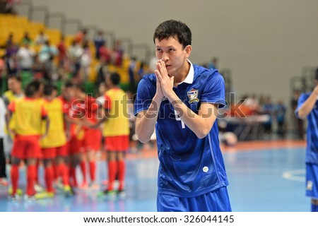 BANGKOK THAILAND-OCT9:Piyapan Rattana of Thailand thanks fans during 2015 AFF Futsal Championship Match between Thailand and Singapore at Bangkok Arena Stadium on October9,2015in Thailand
