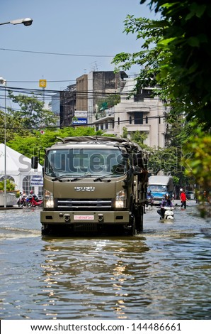 BANGKOK, THAILAND - OCT 31: Royal Thai Army navigates through the flood at Charoen Krung road during the worst flooding on October 31, 2011 in Bangkok, Thailand