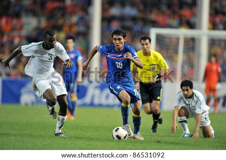 BANGKOK THAILAND - OCT 11: T.Dangda of Thailand in action during FIFA WORLD CUP 2014 between Thailand(B) and Saudi Arabia(W) at Rajamangla Stadium on Oct 11, 2011 Bangkok, Thailand. - stock photo