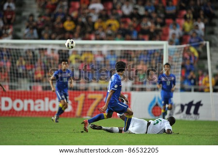 BANGKOK THAILAND - OCT 11: T.Dangda of Thailand in action during FIFA WORLD CUP 2014 between Thailand(B) and Saudi Arabia(W) at Rajamangla Stadium on Oct 11, 2011 Bangkok, Thailand.