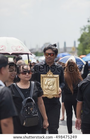 BANGKOK, THAILAND - Oct 14,2016 : Thai people during the funeral procession of a King Bhumibol Adulyadej on October 14,2016 in Bangkok, Thailand.