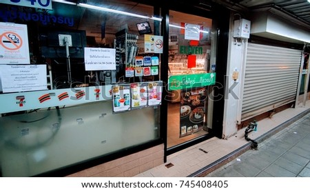 BANGKOK, THAILAND - OCT 26, 2017: The late KingRama 9th's royal cremation day, 7-Eleven put a sign anouncing that 9,800 of 7-Eleven stores close. It's the first time in history that 7-Eleven close.