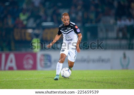 BANGKOK THAILAND-Oct15:Therdsak Chaiman(w)of Chonburi F.C.contols the ball during Thai Premier League Between Army Utd F.C.and Chonburi F.C.at Royal Thai Army Stadium on October15,2014 in Thailand - stock photo