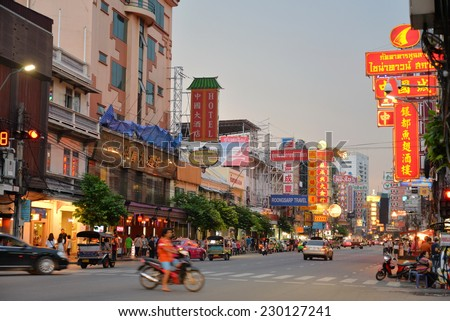 Bangkok, Thailand - October 23, 2014: A view of China Town in Bangkok, Thailand. Street vendors, pedestrians of both locals and tourists, and shoppers in China Town.  - stock photo