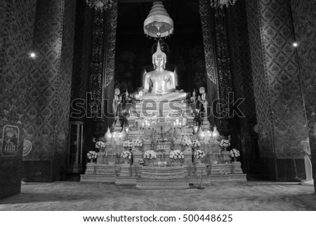 Bangkok - Thailand , October 12 - 2016: Back and white style image of golden Buddha statue and thai art architecture in Wat Bovoranives, Bangkok, Thailand.