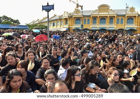 BANGKOK, THAILAND - OCTOBER 14:  Crowd waiting on a street next to the Grade Palace as the Thai King's funeral procession to Grand Palace on October 14th, 2016.