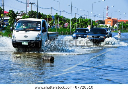 BANGKOK, THAILAND - OCTOBER 31: Flood through the streets of the city during the worst monsoon flood. October 31, 2011 in Bangkok, Thailand.