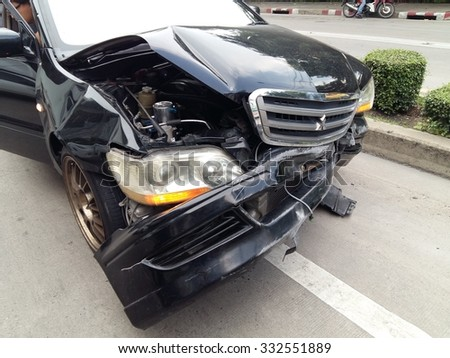 Bangkok, THAILAND - OCTOBER 28 : Front side of black private car damaged after get heavy on the  road accident on october 28  , 2015 in Bangkok, Thailand. - stock photo