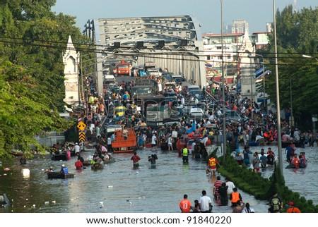 Bangkok, Thailand - OCTOBER 30: Heavy flooding from monsoon rain arriving in Bangkok suburbs on October 30, 2011 in Bangkok, Thailand. - stock photo