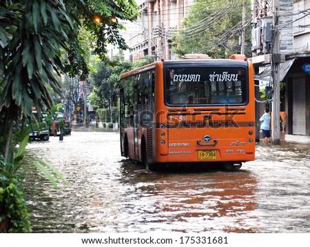 BANGKOK, THAILAND - OCTOBER 30 : Heavy flooding from monsoon rain in Ayutthaya and north Thailand arriving in Bangkok on October 30,2011 Bangkok, Thailand - stock photo