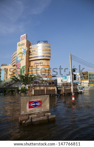 BANGKOK, THAILAND - OCTOBER 16: Huge flood disaster in Thailand. As a result, unidentified people have to be evacuated from their houses - October 16, 2011 in Bangkok, Thailand  - stock photo