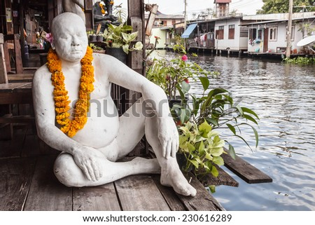 BANGKOK, THAILAND - OCTOBER 02, 2014: Man statue in front of Bangkok Artist's House. Bangkok Artist's House is Thai Puppet Theatre that located on Bang Luang canal Bangkok Thailand. - stock photo