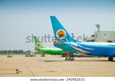 BANGKOK, THAILAND - October 16, 2014: Nok Air plane at Donmueng International Airport on Oct 14, 2014 in Bangkok, Thailand. Nok Air is the budget airline of Thai Airways International. - stock photo