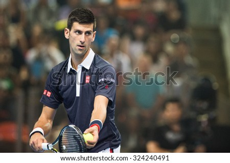 BANGKOK THAILAND OCTOBER 02:Novak Djokovic of Serbia serves the ball during the Black to Thailand Nadal vs Djokovic exhibition match at Hua Mark Indoor Stadium on Oct 2, 2015 in,Thailand. - stock photo