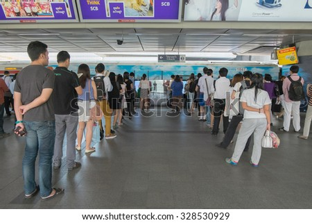 Bangkok, Thailand - 16 October 2015 - People standing in lines waiting for BTS sky train at Siam station on 16 October 2015 in Bangkok Thailand - stock photo