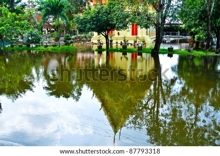 BANGKOK, THAILAND - OCTOBER 31: Reflection of the temple. Flooded roads and places of the city during the worst monsoon flooding, October 31, 2011 in Bangkok, Thailand. - stock photo