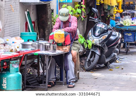 BANGKOK, THAILAND - 2015 October 23: Unidentified Thai massager doing spa massage to traveller in Bangkok, Thailand.