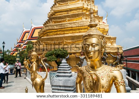 BANGKOK, THAILAND - OCTOBER 24, 2015: Unidentified tourists at Wat Phra Kaew in Bangkok, Thailand. Wat Phra Kaew is one of the most popular tourists destination,Bangkok,Thailand on October 24,2015