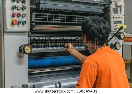 Bangkok, Thailand - October 24, 2015 :  Unidentified worker working for control and monitor printing in printery at Bangkok, Thailand.