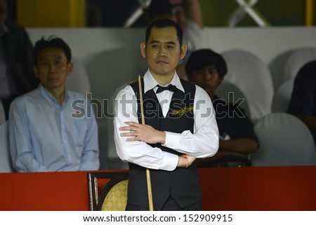 BANGKOK,THAILAND-SEP 3,2013: Dechawat Poomjaeng player of Thailand in action during Snooker 6-Red World Championship 2013 at Montien Riverside? hotel on September 3,2013 in Bangkok, Thailand
