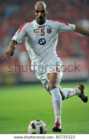 BANGKOK, THAILAND-SEP 27:KH.Al shammari of  Kuwait in action during AFC Cup between Muang Thong UTD(R) and Kuwait Fc(W) at Yamaha Stadium on September 27, 2011 in Bangkok, Thailand - stock photo