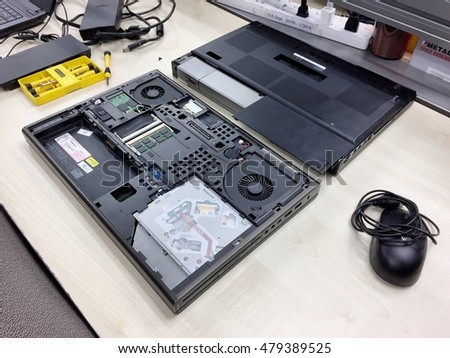 BANGKOK THAILAND 6 SEP 2016 : Laptop disassembled for repair and change hard disk on the table