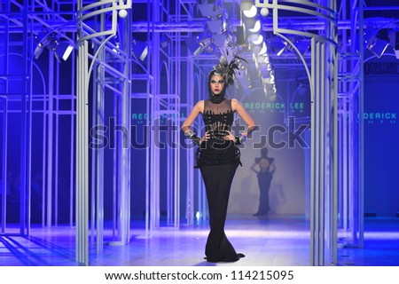 "BANGKOK, THAILAND - SEP 29 : Model walks the runway at "" Frederick Lee"" collection presentation during Siam Paragon International Couture Fashion Week 2012 on September 29, 2012 in Bangkok Thailand."