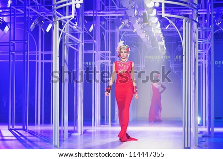 "BANGKOK, THAILAND - SEP 29 : Model walks the runway at "" Frederick Lee "" collection presentation during Siam Paragon International Couture Fashion Week 2012 on September 29, 2012 in Bangkok Thailand."