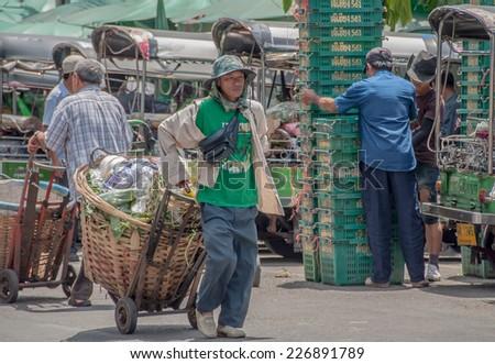 BANGKOK,THAILAND - SEP 20:Unidentified man transports vegetable waste at Pak Khlong Talat  market in Bangkok,Thailand on 20 September 2013. - stock photo
