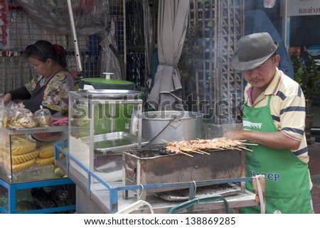 BANGKOK, THAILAND - SEPT 17: A street vendor in Chinatown on September 17th 2012. Authorities are seeking cooperation  of vendors operating illegally instead of arrests and fines.