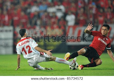 BANGKOK, THAILAND-SEPT 27: Nattaporn Panrit of  MTUTD in action during AFC Cup between Muang Thong UTD(R) and Kuwait Fc(W) at Yamaha Stadium on September 27, 2011 in Bangkok, Thailand - stock photo