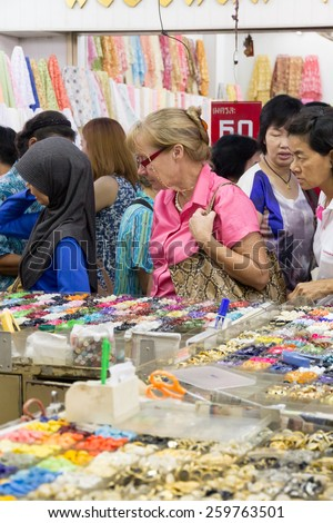 Bangkok, Thailand-Sept 20th 2014: Shoppers in Sampeng Lane. The lane is a famous shopping street in Chinatown. - stock photo