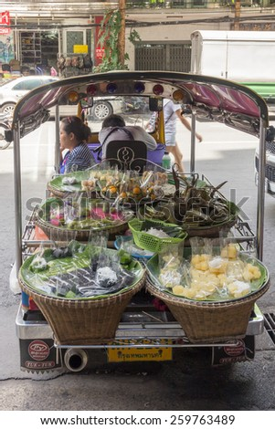 Bangkok, Thailand-Sept 20th 2014: Vendor selling from a tuk tuk. Tuks tuks are usually used to transport people. - stock photo