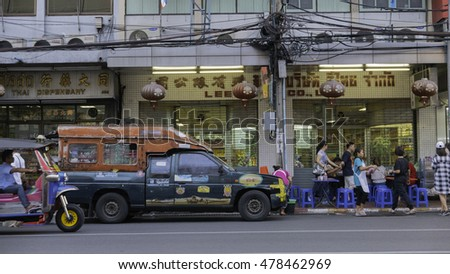 Bangkok, Thailand - September 3, 2016: Classic old car on chinatown (Yaowarat) Road,the main street in Chinatown, once of Bangkok landmark and important street.