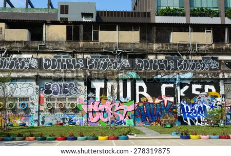 BANGKOK, THAILAND - SEPTEMBER 18, 2014. Giant graffiti on abandoned building of Bangkok in Bangkok, Thailand. - stock photo