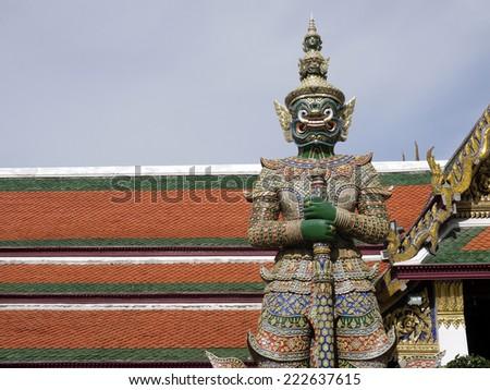 BANGKOK, THAILAND -September 14: Giant guardian at Temple on 14 September 2014 at ancient Buddhist Temple (Wat Pra Kaew) in the Royal Grand Palace, Bangkok ,Thailand - stock photo
