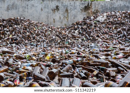 Bangkok, Thailand-September 18, 2016: Glass bottles of various drinks in the yard of a company specializing in ecological treatments. Large heap of glass bottles and containers for recycling.