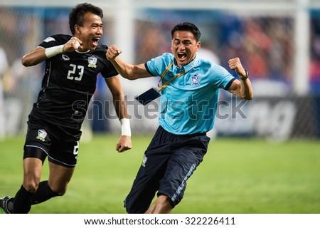 BANGKOK,THAILAND SEPTEMBER 08:Head coach Kiatisuk Senamuang (R)of Thailand celebrate during the 2018 FIFA World Cup Qualifier between Thailand and Iraq at Rajamangala Stadium on Sep8,2015 in Thailand. - stock photo