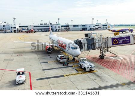 BANGKOK, THAILAND - 12 SEPTEMBER 2015 - Jet way from terminal to Boeing 737 aircraft at Don Mueang International Airport. - stock photo