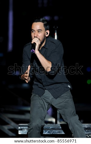 BANGKOK, THAILAND-SEPTEMBER 23: Mike Shinoda of Linkin Park performs on Linkin Park Live in Bangkok A Thousand Suns World Tour 2011 at Impact Maungthong Thani, September 23, 2011 in Bangkok, Thailand