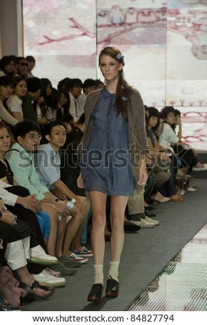 BANGKOK, THAILAND - SEPTEMBER 16 : Model walks on the catwalk during Thailand Graduate Fashion Week 2011 on September 16, 2011 in Bangkok Thailand.